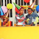 the kids with birthdays sit at the place of honor, and are treated to cake, fruit and pop!